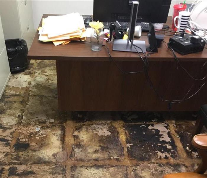 office with carpet removed and wood desk