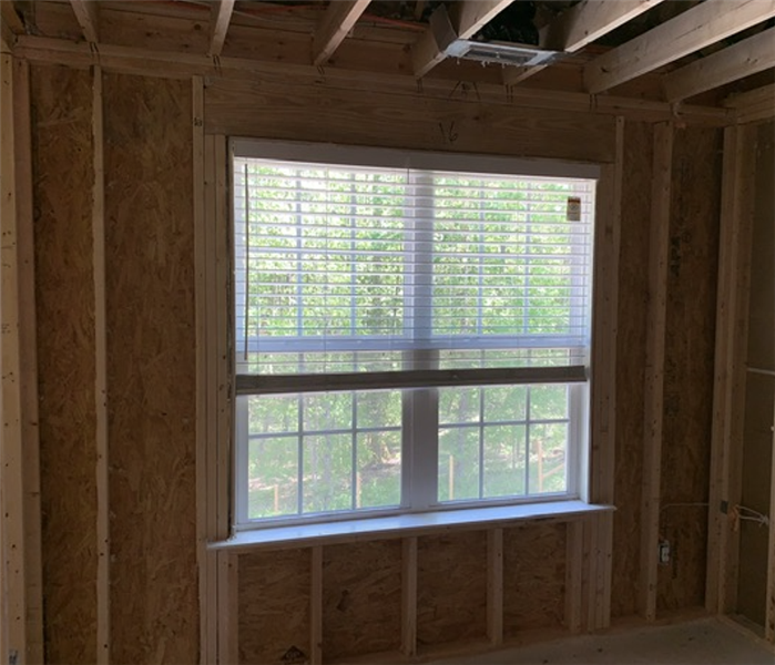 Wall and window with wood framing exposed