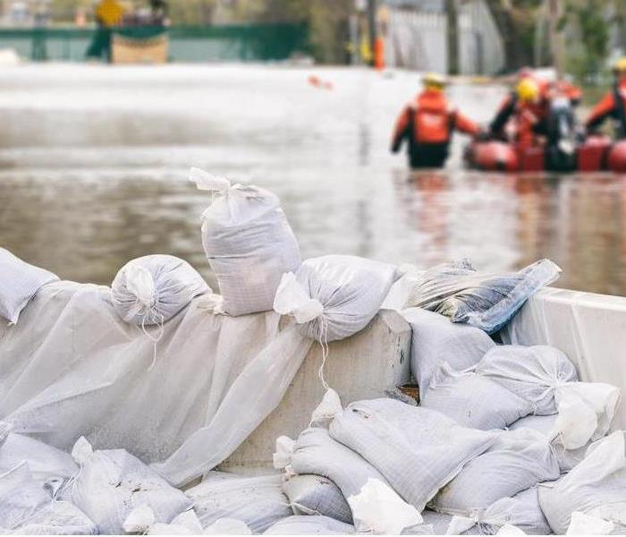 flooded area with sand bags up to prevent commercial damage to local businesses