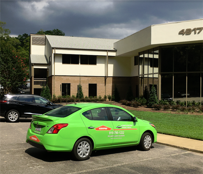 SERVPRO car in front of a business building